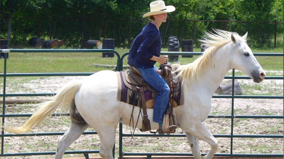 Amanda riding her beloved horse, Snowflake. (Photo courtesy of the Stevens)