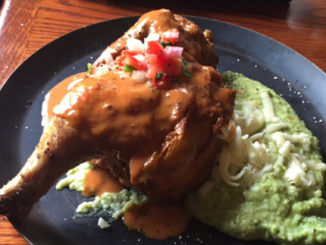 Roasted chicken with green chile cheese grits. (Photo courtesy of Steve Stevens)