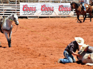 Cowboys competing in the double mugging contest. (Photo by Jody Blackwell West)