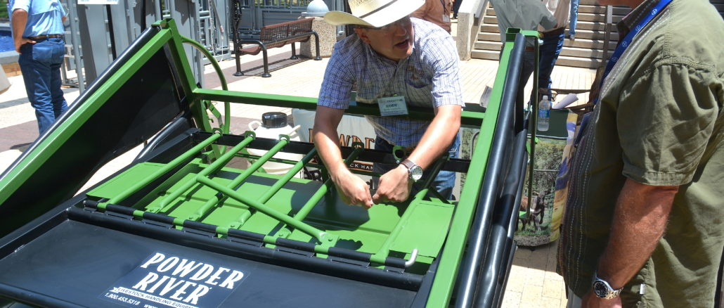 Kody Lucherk, Powder River territory sales manager, demonstrates a calf table at the 62nd Texas A&M Beef Cattle Short Course. (Texas A&M AgriLife Extension Service photo by Blair Fannin)