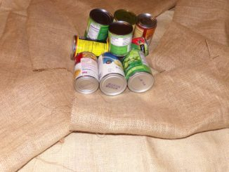 The tin cans and burlap represent what the young men used back in 1946 to construct the giant snake. (Photo by Judy Wade)
